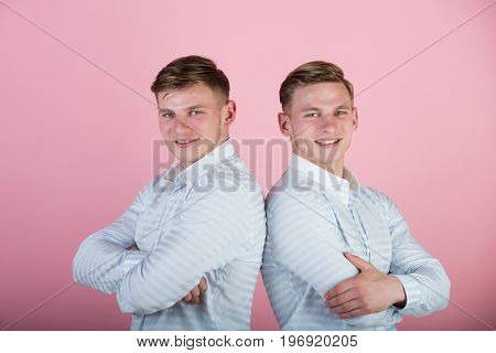 Two Brothers Smiling On Pink Background