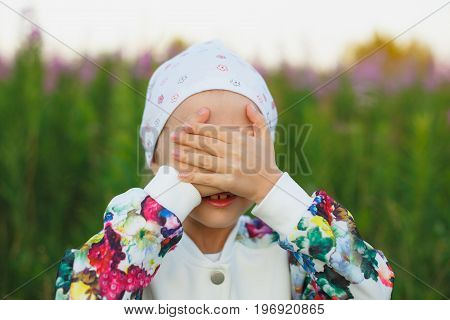 Little Girl Hiding Face Outdoor Portrait