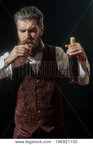 Man With Bottle Drinking Glass Of Red Wine