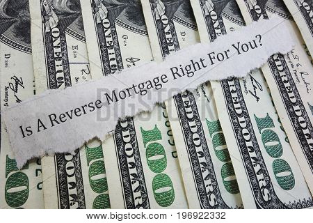 A Reverse Mortgage headline on assorted money