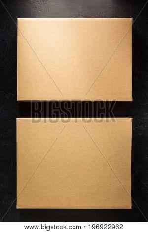 cardboard box on black background surface