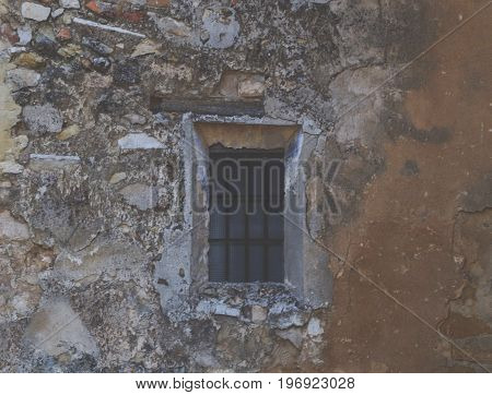 Old window in a wall of the same type