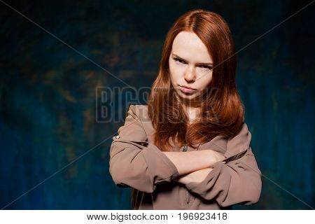 scared red-haired girl in brown shirt posing. beauty model woman with luxurious red hair. hairstyle. holiday makeup
