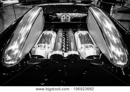 BERLIN - MAY 02 2015: Showroom. Engine of a supercar Bugatti Veyron EB 16.4. Fastest serial car in the world. Rear view. Black and white. Produced from 2005 to 2011