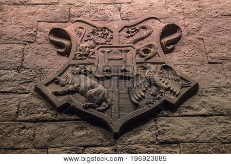 LEAVESDEN UK - JUNE 19TH 2017: The Hogwarts coat of arms on the set of the Great Hall at Hogwarts at the Making of Harry Potter studio tour at the Warner Bros studios in Leavesden UK on 19th June 2017.
