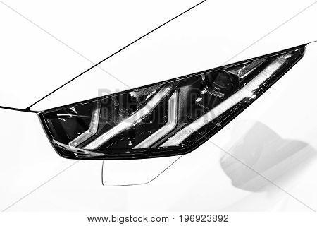 BERLIN - MAY 02 2015: Showroom. LED Headlamp of a sports car Lamborghini Huracan Lr 610 4. Black and white. Produced since 2014.