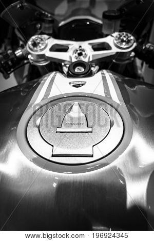 BERLIN - MAY 02 2015: Showroom. The fuel tank of a sport bike Ducati 1299 Panigale by Ducati Corse racing team. Black and white. Produced since 2015.
