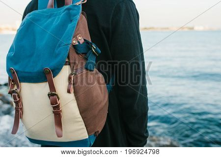A tourist with a backpack on the coast. Travel, tourism.