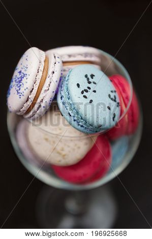 Blue and pink macaroons in a glass. Decor for party.