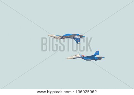 BELGOROD RUSSIA - JULY 15 2017: Russian military jet fighters su-30 sm Flanker-C. Aerobatics pair performed the