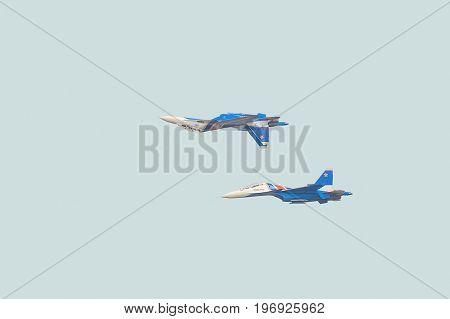 BELGOROD RUSSIA - JULY 15 2017: Russian military jet fighters su-30 sm Flanker-C. Aerobatics pair performed the
