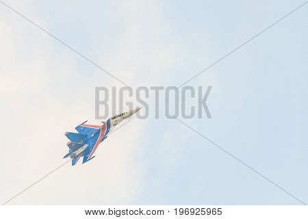 BELGOROD RUSSIA - JULY 15 2017: Russian military aircraft-fighter su-30 sm Flanker-C in the sky gaining height. Highly maneuverable combat and strike heavy jet fighter of aerospace forces Russian Federation.