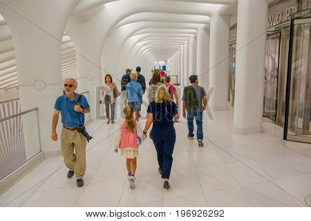 NEW YORK, USA - MAY 05, 2017: Unidentified passengers pass under the distinctive architectural, form of the Oculus transportation hub in New York Usa.