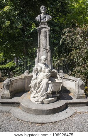 A monument dedicated to French singer poet songwriter and composer Alexandre Joachim Desrousseaux in Lille France.
