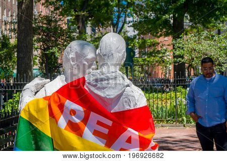 ORLANDO, USA - MAY 05, 2017: Staue with a gay flag with the word peace, in shooting memorial gay in Orlando, Florida, United States.