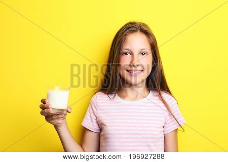 Portrait Of Beautiful Girl With Glass Of Milk On Yellow Background