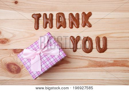 Thank You written by chocolate cookies alphabet with gift box