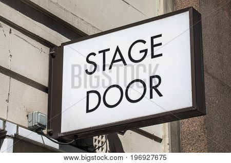 A Stage Door sign at a theatre.
