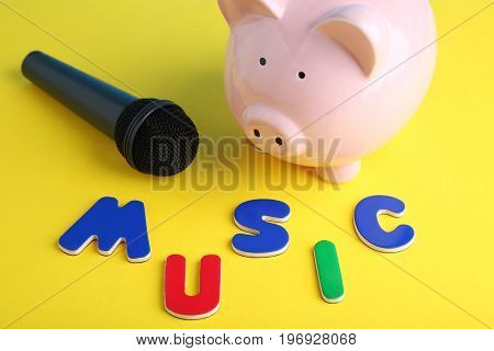 Black microphone with piggybank and inscription Music