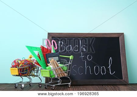 Shopping Carts With Stationery And Inscription Back To School