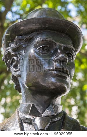 LONDON UK - JUNE 14TH 2017: A statue of famous actor Charlie Chaplin located in Leicester Square in London UK on 14th June 2017.