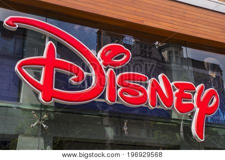 LONDON UK - JUNE 14TH 2017: The Disney logo above the main entrance to the Disney store on Oxford Street in central London UK on 14th June 2017.