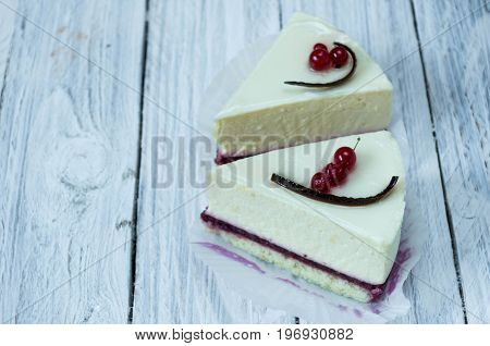 Two White Cheesecakes On A White Background.