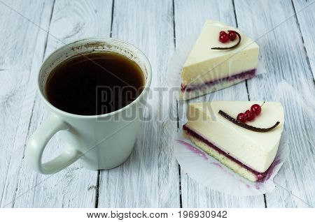 White Mug With Black Instant Coffee And White Cheesecakes. Fron View.