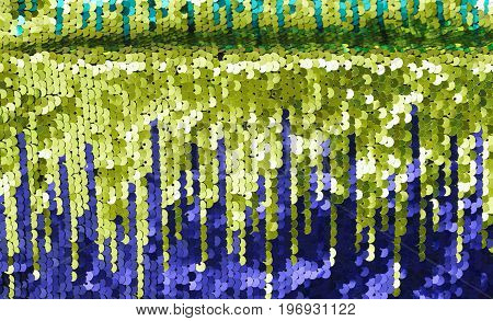Background sequin. sequin BACKGROUND. glitter surfactant. Holiday abstract glitter background with blinking lights. Fabric sequins in bright colors. Fashion fabric glitter sequins