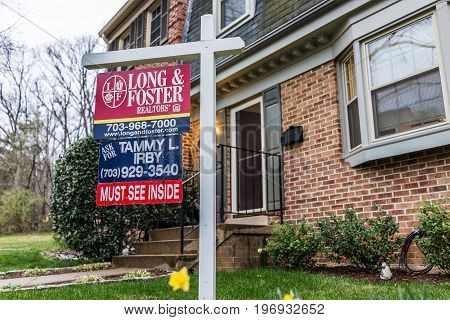 Fairfax, Usa - March 7, 2017: Long And Foster Real Estate Sign In Front Of Townhouse With Yellow Daf