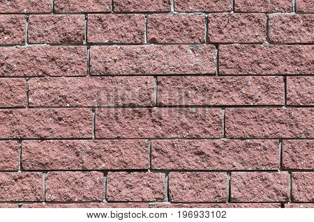 The wall and the bricks are red or brown. Masonry of bricks laid horizontally. The joints between the bricks with cement.