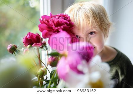 Cute Little Child And Amazing Bouquet Of White And Purple Peonies