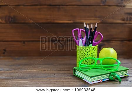 The book pencils and pens for school. Background. The concept is back to school.
