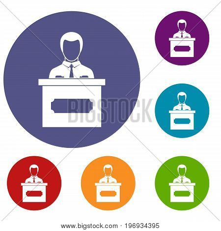 Businessman giving a presentation icons set in flat circle red, blue and green color for web
