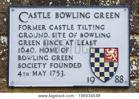 A plaque at Castle Bowling Green in Lewes detailing the history of the landmark.
