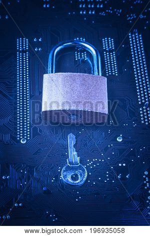 Padlock with a key on computer motherboard. Internet data privacy information security concept. Blue toned image