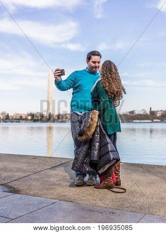 Washington Dc, Usa - March 17, 2017: Couple Taking A Selfie At Tidal Basin With Washington Monument