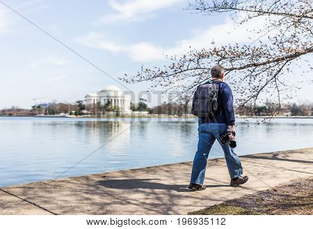 Washington Dc, Usa - March 17, 2017: Photographer Walking Along Tidal Basin With Thomas Jefferson Me