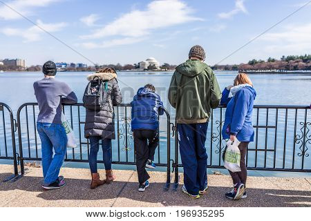 Washington Dc, Usa - March 17, 2017: People Looking Over Tidal Basin And Thomas Jefferson Memorial B