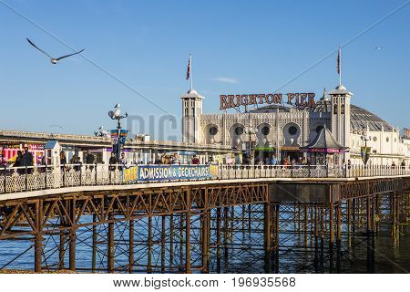 BRIGHTON UK - MAY 31ST 2017: A view of the historic Brighton Pier in Brighton UK on 31st May 2017.