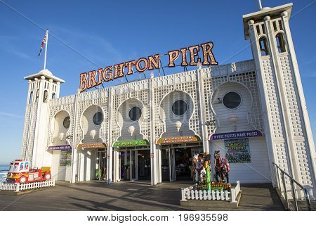 BRIGHTON UK - MAY 31ST 2017: A view of the main building housing amusements on the historic Brighton Pier in Brighton UK on 31st May 2017.