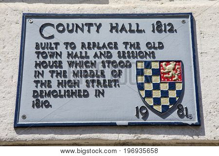 LEWES UK - MAY 31ST 2017: The plaque at County Hall in Lewes East Sussex detailing the building's history on 31st May 2017.