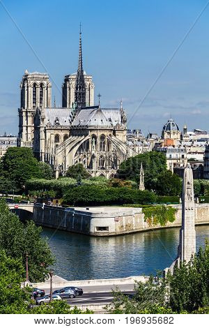 View of southern facade of Notre Dame de Paris Cathedral on the Cité Island. Notre Dame Cathedral is a medieval catholic cathedral and finest example of french gothic architecture. Paris France.