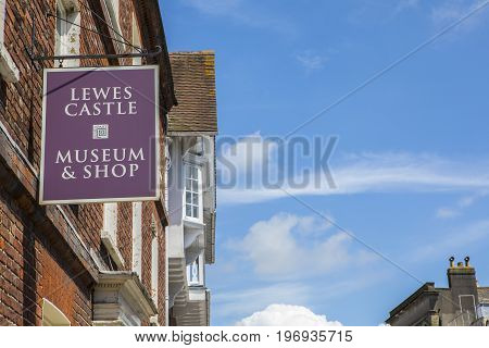 LEWES UK - MAY 31ST 2017: A sign at the Lewes Castle Museum and Shop in the historic town of Lewes in East Sussex UK on 31st May 2017.