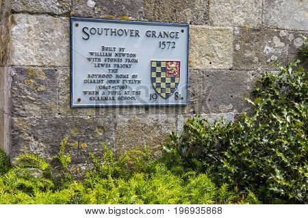 LEWES UK - MAY 31ST 2017: A plaque at Southover Grange detailing its history in the historic town of Lewes in East Sussex UK on 31st May 2017.