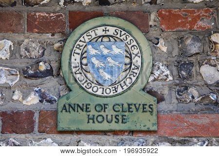 LEWES UK - MAY 31ST 2017: A plaque at Anne of Cleves House in the historic town of Lewes in East Sussex UK on 31st May 2017.