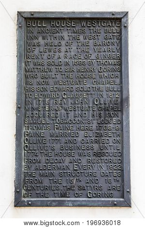 LEWES UK - MAY 31ST 2017: A plaque at Bull House in the historic town of Lewes in East Sussex UK on 31st May 2017. The plaque details the history of the building.