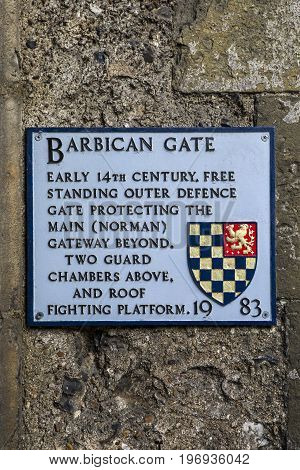 LEWES UK - MAY 31ST 2017: A plaque at the Barbican Gate in the historic Lewes Castle in East Sussex UK on 31st May 2017.