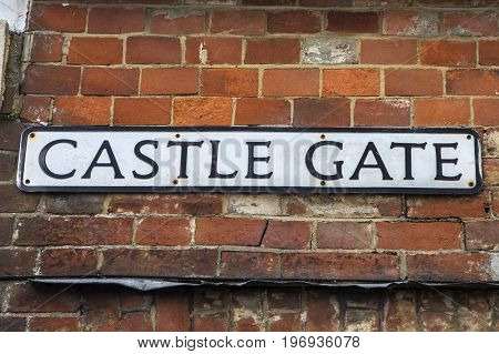 LEWES UK - MAY 31ST 2017: Street sign for Castle Gate in the historic town of Lewes in East Sussex UK on 31st May 2017.