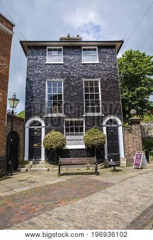 LEWES UK - MAY 31ST 2017: A black-tiled Georgian House situated next to Lewes Castle in the historic town of Lewes in East Sussex UK on 31st May 2017.